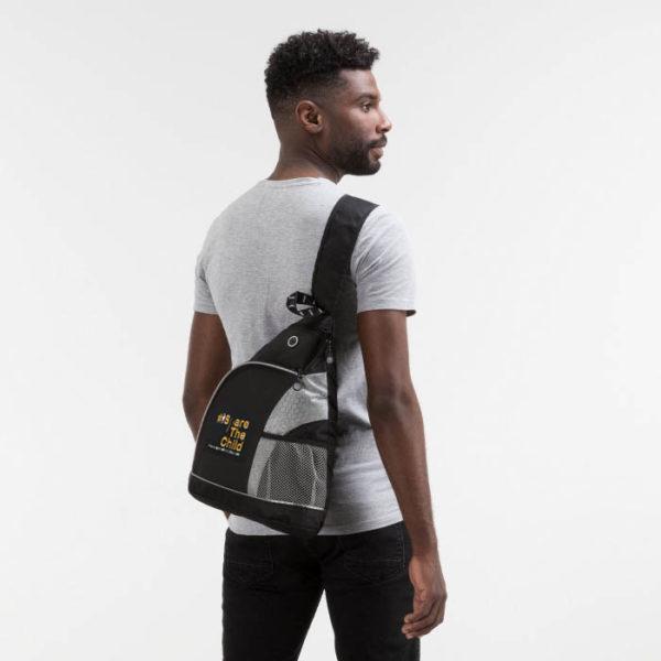 SpareTheChld-slingbag-model